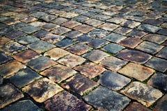 Detail der bunten alten Steinpflasterung Stockfotografie