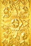 Detail der goldenen geprägten Tür Lizenzfreie Stockfotografie