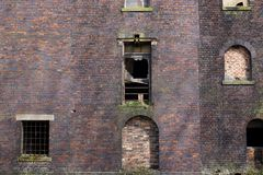 Detail of Derelict Brick Building, Boarded Windows Stock Photo