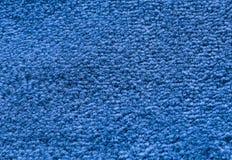 Detail des blauen flaumigen Gewebe-Beschaffenheits-Hintergrundes Stockbilder