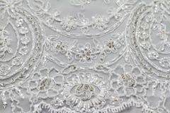 Detail des Hochzeitskleides Stockfotos