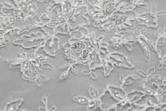 Detail des Hochzeitskleides Stockbild