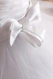 Detail des Hochzeitskleides Stockbilder