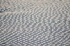 Detail des Sandes auf dem Strand Lizenzfreies Stockbild