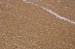 Detail des Sandes und des Wassers stockbild