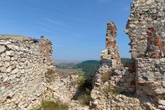 Detail of destroyed ruined walls of medieval Rasnov citadel in R Stock Images