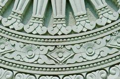 Detail of Dhammajak molding art Royalty Free Stock Image
