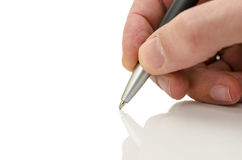 Detail die van zakenmanhand een pen houden Stock Foto's