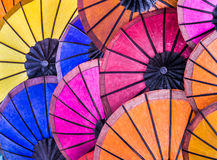 Multicolored Umbrellas at Night Market - South East Asia. Detail of different colors from asiatic umbrellas at a night street market Royalty Free Stock Photo