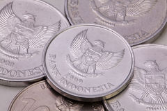 Indonesian rupiah  coins on the table. Detail of different Indonesian rupiah  coins on the table Royalty Free Stock Photos