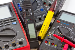 Detail of different portable multimeters Stock Images