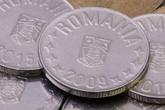 Detail of different Romania Leu coins. On the table Stock Photos