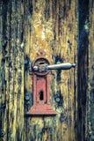 Dilapidated door with Red door handle stock photos