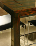 Detail of dining table. Dining table and chairs with wood grain detail Royalty Free Stock Photography