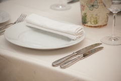 Detail of a dining table set up with wine glasses Stock Photo