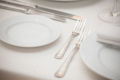 Detail of a dining table set up with wine glasses Stock Images