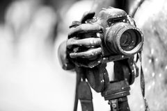 Detail of dirty dslr camera. Equipment mistreat. Black and white. Royalty Free Stock Photo