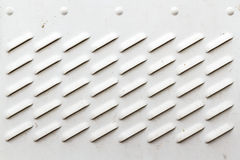 Detail of Dirty White Panel with Ventilation Grilles. Including copy space Stock Images