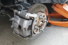 Detail of disc brake system of a car without the wheel to recap. The tire Royalty Free Stock Image