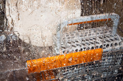 Detail of a dishwasher running Royalty Free Stock Images