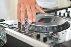 Detail of a dj hands Stock Images