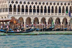 Detail of the Doge's Palace on Saint Mark`s square and gondolas. Venice, Italy Stock Photo