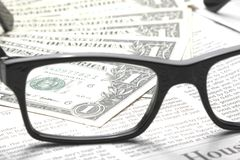 Detail of dollars on business newspaper Stock Photos