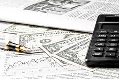 Detail of dollars near calculator Stock Photo