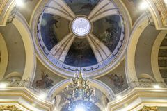 Detail of a dome of a european church. With old paintings stock image