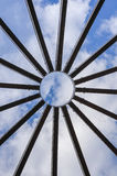 Detail of dome structure. Detail of an open dome structure made of wood through which the sky is visible Stock Image