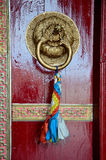 Detail or door in Buddhist temple. Royalty Free Stock Photo