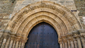 Detail of Door of Forgiveness on romanesque church of Santiago stock image