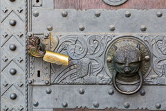 Detail of door with handle and knocker. Stock Photography