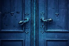 The detail with door handles on the old church door royalty free stock images