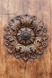 Detail of door. Detail of old wooden door with a hand-carved flower Stock Image