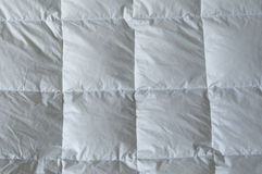 Detail of down comforter. With white squares Royalty Free Stock Photo