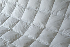 Detail of down comforter. With white squares Stock Photography
