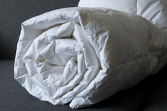 Detail of down comforter. Detail of a rolled white down comforter Royalty Free Stock Photo