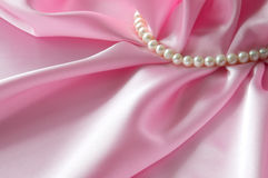 Detail of draped white and pink silk fabric with pearl Royalty Free Stock Image