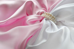 Detail of draped white and pink silk fabric with pearl Stock Photography