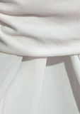 Detail of a draped white table cloth Stock Photos