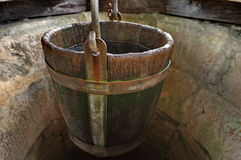 Traditional Draw-well with wooden bucket Stock Photos
