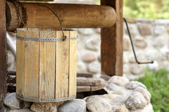 Detail of draw well with wooden bucket Royalty Free Stock Photos
