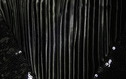 Detail of a dress from black silk Royalty Free Stock Images