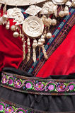 Detail of the dress of a chinese ethnic minority woman Royalty Free Stock Image