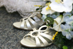 Detail of dress and shoes. Closeup of bride's shoes and bouquet Stock Photo