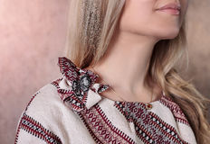 The detail of the dress with traditional ornament Stock Photos