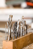 Detail of drills on workshop table, Royalty Free Stock Images