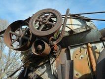 Antique oil field equipment detail apudder pumping machine. Detail drive wheels leaver antique oilfield spudder pumping equipment historical royalty free stock photo