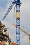 Dump and two new cranes. Detail of a dump because of demolition with two new colorful cranes Stock Images
